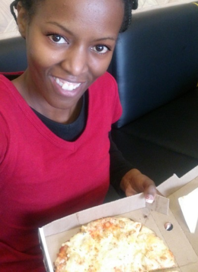 Phindiwe Nkosi with Debonairs Pizza's Real Deal Creamy Chicken [pizza] at Gezina Galleries.