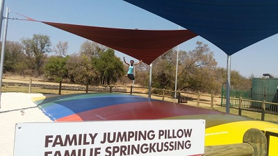 "Phindiwe Nkosi jumping on the ""Family Jumping Pillow"" at Dikhololo Game Reserve. Photo by S NB"