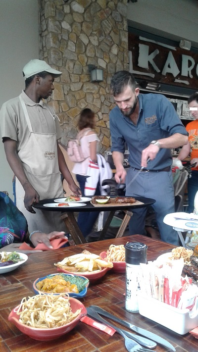 Staff members from Karoo Grill & Bar Restaurant carving meat. Photo by PN.